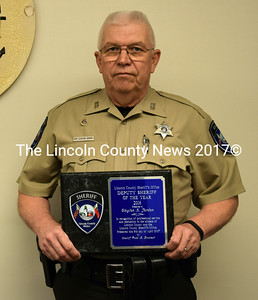 Lincoln County Sheriff's Deputy Clayton Jordan holds his Deputy Sheriff of the Year plaque in District Court in Wiscasset on May 5. (J.W. Oliver photo)