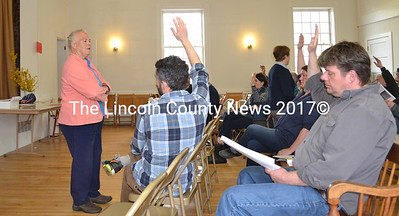 Frances Mague counts hands during a vote on library funding at Edgecomb's annual town meeting Saturday, May 13. (Abigail Adams photo)