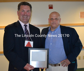 Hall Funeral Home President Mike Hall was presented the Damariscotta Region Chamber of Commerce's Business Person of the Year Award by outgoing board member John Bottero during the chamber's annual meeting Thursday, May 18. (Maia Zewert photo)