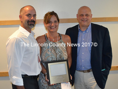 From left: Supplies Unlimited owners Gary and Jane Gravel accept the Damariscotta Region Chamber of Commerce's Organizational Community Service Award from outgoing board member John Bottero during the chamber's annual meeting Thursday, May 18. (Maia Zewert photo)