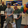 From left: Dustin Campbell, Coastal Humane Society trainer Mike Gould, and Norman Palmer present recue dogs Jake (left) and Melvin with certificates of completion upon their graduation from Two Bridges Regional Jail's new dog obedience program Tuesday, May 23. (Abigail Adams photo)