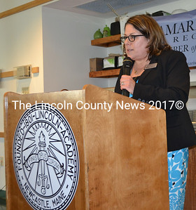 Damariscotta Region Chamber of Commerce Executive Director Stephanie Gallagher speaks during the chamber's annual meeting in the Lincoln Academy Alumni Dining Commons the evening of Thursday, May 18. (Maia Zewert photo)