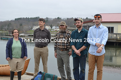 From left: Damariscotta River Association Education Director Sarah Gladu, DRA Executive Director Steven Hufnagel, master boat-builder Steve Cayard, boat-building intern Dan Asher, and intern Tobias Francis, the son of late Passamaquoddy master boat-builder David Moses Bridges, stand on the town landing during the April 27 launching ceremony for the birchbark canoe built by Cayard, Asher, Tobias, and Lincoln Academy students. (Christine LaPado-Breglia photo)