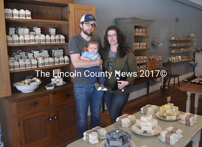 Long Winter Farm Soap Co. owners Lucas McNelly and Amanda Nelson and their son, Rhys McNelly, in their new store at 11 Friendship St. in Waldoboro. The store will celebrate its grand opening Saturday, May 6. (Maia Zewert photo)