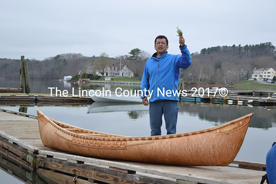 Passamaquoddy elder Dwayne Tomah gives a blessing in both Passamaquoddy and English before the boat is launched into the Damariscotta River for its first ride. (Christine LaPado-Breglia photo)