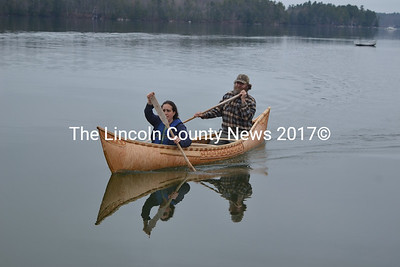 Sarah Gladu and Steve Cayard return to shore on the maiden voyage of the traditional Wabanaki canoe built by Cayard and others in Lincoln Academy's Cable-Burns Applied Technology and Engineering Center. (Christine LaPado-Breglia photo)