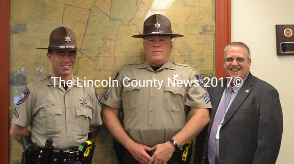 Lincoln County Sheriff Todd Brackett (right) recognized Deputy 1st Class Brian Collamore (left) and Sgt. Alan Shea (center) for lifesaving actions during the Lincoln County Board of Commissioners meeting Tuesday, May 2. (Charlotte Boynton photo)