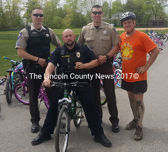 From left: Lincoln County Sheriff's Office Sgt. Aaron Beck, Damariscotta interim Police Chief Jason Warlick, Lincoln County Sheriff's Deputy Chase Bosse, and David DeFosses at Great Salt Bay Community School's Bike Rodeo on Wednesday, May 24. (Remy Segovia photo)