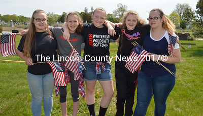 From left: Whitefield Elementary School students Kadince Rideout, Emma Elwell, Mia Northrup, Natalie Spearin, and Destyni Grass placed flags on veterans' graves at the Mt. Hope Cemetery in Augusta on Wednesday, May 24. (Carrie Reynolds photo)
