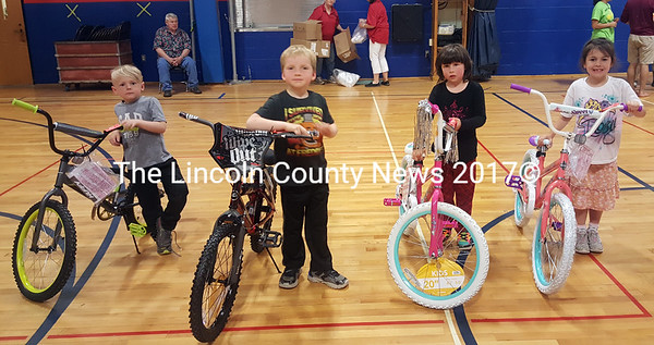 From left: winners Madox Gregory, William Nery, Ava Ward, and Rosie Adams with their new bikes. (Remy Segovia photo)