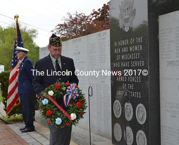 Wiscasset Legionnaire Neil Page lays a wreath at the veterans monument during the Memorial Day service in Wiscasset. (Charlotte Boynton photo)