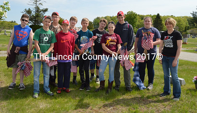 Whitefield Elementary School eighth-graders placed flags on veterans' graves for Memorial Day. (Carrie Reynolds photo)