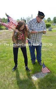 Whitefield Elementary School student Gracie Bowen locates the graves of veterans at the Mt. Hope Cemetery in Augusta with the help of American Legion Post 2 member Alvah Donnell on Wednesday, May 24. (Carrie Reynolds photo)