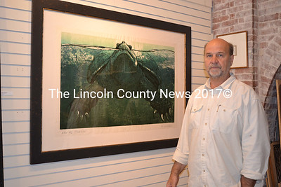 """Wiscasset artist R. Keith Rendall stands before his large woodcut of a snapping turtle, """"Noli Me Tangere,"""" which took him about seven to eight months to create. (Christine LaPado-Breglia photo)"""