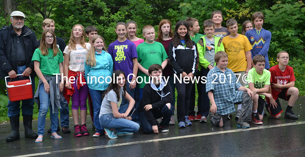 Herb Hartman (left) with the Whitefield Elementary School sixth-grade class after they released Atlantic salmon fry into the Sheepscot River on Friday, June 16. (Abigail Adams photo)