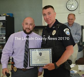Interim Damariscotta Police Chief Jason Warlick presents Officer Erick Halpin with a Lifesaving Award during annual town meeting Wednesday, June 14. (Maia Zewert photo)