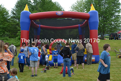 Families wait in line at the bounce house on Waldoboro Day. (Remy Segovia photo)