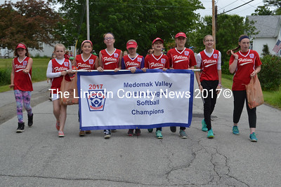 The Medomak Valley Little League softball champions, the Fillies, walk in the Waldoboro Day parade. (Remy Segovia photo)