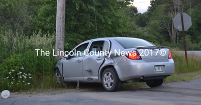 A 2007 Chervolet sedan came to a stop against a telephone pole after its driver failed to stop at a stop sign and struck a pickup truck hauling a boat in Waldoboro the evening of Sunday, June 25. (Maia Zewert photo)