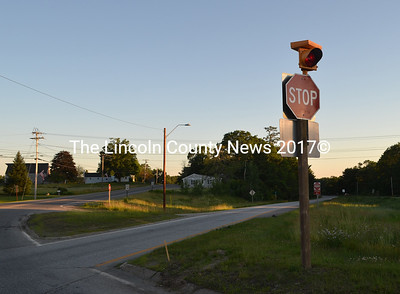 A flashing red light atop the stop sign at the intersection of Route 1 and Main Street in Damariscotta fulfills the first recommendation of a committee that reviewed the safety of two Route 1 intersections. (Maia Zewert photo)