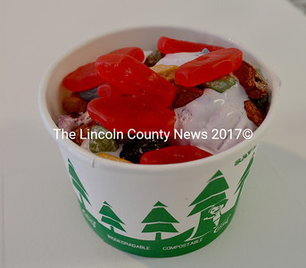 """Wicked Scoops' DRA Sundae includes a scoop of ice cream, gummy fish, and chocolate """"river rocks."""" For every sundae it sells, the business will donate $1 to the Damariscotta River Association. (Maia Zewert photo)"""