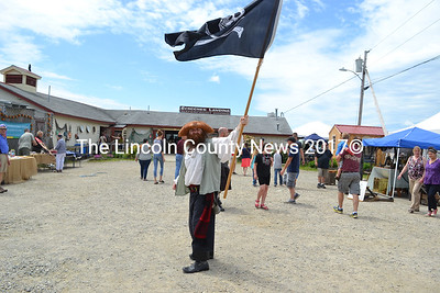 A pirate waves his flag to signal the impending pirate attack. (Remy Segovia photo)