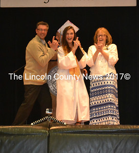 Lincoln Academy graduate Carly Renee Ransdell strikes a pose with advisers Brian Smalley and Cynthia Ferrill after receiving her diploma Thursday, June 1. (Abigail Adams photo)