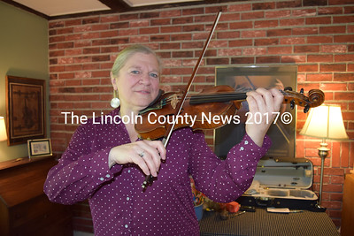 Preston Music Studio owner Carol Preston poses with her violin, one of the instruments she teaches her students how to play. (Remy Segovia photo)