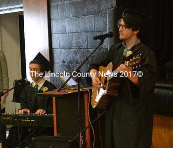 "Gabriel Manuel Ferrero (left) and Noah Conley Jones perform ""Rivers and Roads"" by The Head and the Heart during the Thursday, June 1 commencement ceremony. (Abigail Adams photo)"