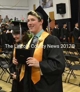 Lincoln Academy Class of 2017 Salutatorian Jacob Thomas Brown exits the Lincoln Academy gym with his diploma Thursday, June 1. (Abigail Adams photo)