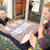 """October Brown, 7, gets her fortune read by Skidompha Library Director of Development and Communications Torie DeLisle during the library's """"A Wrinkle in Time"""" event Saturday, March 17. (Jessica Picard photo)"""
