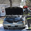 Firefighter Chris Hilton sprays a car that was on fire next to the Damariscotta United Methodist Church on Monday, April 23. (Jessica Picard photo)
