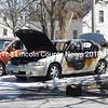 Firefighter Chris Hilton sprays a car that was on fire next to the Damariscotta United Methodist Church on Hodgdon Street on Monday, April 23. (Jessica Picard photo)