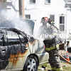 Firefighter Chris Hilton works to put out a car fire next to the Damariscotta United Methodist Church on Monday, April 23. (Jessica Picard photo)