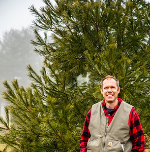 David Karas stands in front of a white pine at Echo Hill Choose and Cut in Waldoboro on Sunday, Dec. 13. A pine from Karas' nursery is representing Lincoln County at the Blaine House in Augusta. (Bisi Cameron Yee photo)