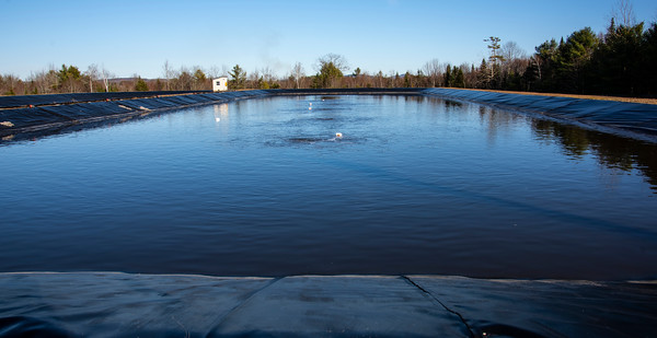 Large aerators mix wastewater in the treatment lagoon at the Waldoboro Utility District on Dec. 3. Keeping the wastewater in motion allows bacteria to find and break down waste materials, ultimately leaving potable water that is then sprayed onto surrounding fields. (Bisi Cameron Yee photo)