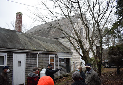 Michael Noetzel (pointing) explains his renovation plans for 639 Main St. to the Damariscota Planning Board and others during a site visit on Monday, Dec. 14. Noetzel is applying to open a recreational cannabis storefront and Tier 2 cultivation facility at the location. (Evan Houk photo)