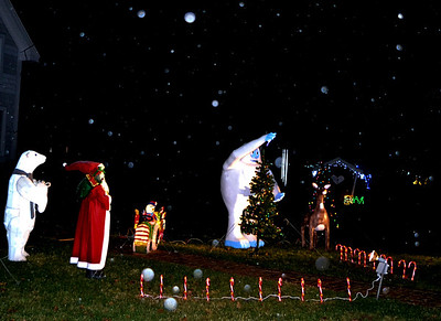 Snow falls on a North Pole display at the Morrison home, at 2634 Bristol Road in New Harbor. Visitors are welcome for photo-ops, as long as they wear masks and observe physical distancing. (Nettie Hoagland photo)