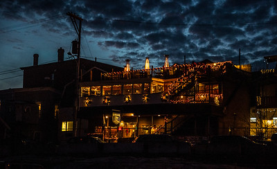 The lights of the Boat House Bistro glow against a darkening sky in Boothbay Harbor on Friday, Dec. 11. (Bisi Cameron Yee photo)