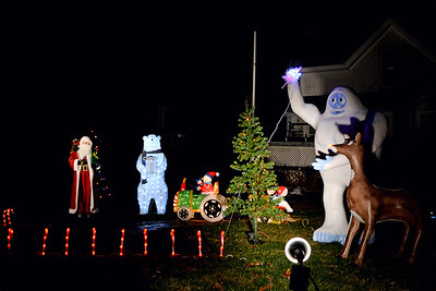 A Christmas display lights up the night at the Morrison home, next to Sugar Spell Sweets in New Harbor. (Nettie Hoagland photo)