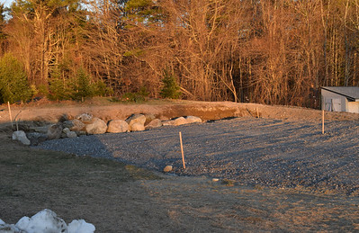 The site of a future greenhouse behind Great Salt Bay Community School in Damariscotta on Tuesday, Dec. 15. Margaret Coleman, agriculture coordinator at the school, expects the greenhouse to be up by fall 2021. (Evan Houk photo)