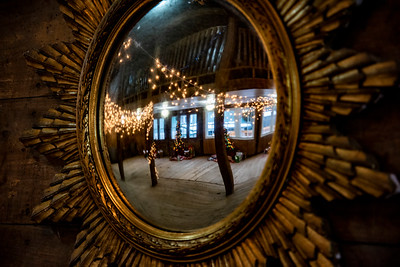 A mirror reflects the holiday spirit at Le Barn in Jefferson on Saturday, Dec. 12. Marie Lindsey, owner of Le Barn since 2015, opened up the space so Jefferson residents could safely donate gifts and ensure the community's children had presents under the tree on Christmas morning. (Bisi Cameron Yee photo)