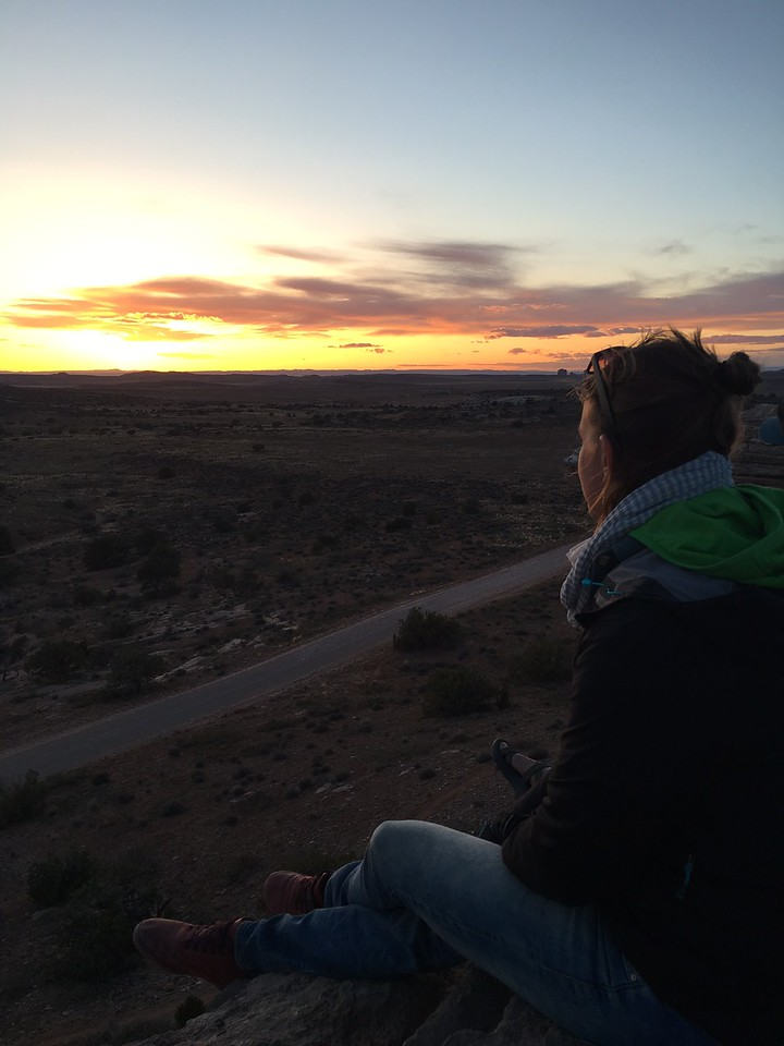 Abby taking in the sunset from Lone Mesa toward Canyonlands NP.<br /> Photo Jenna Walenga