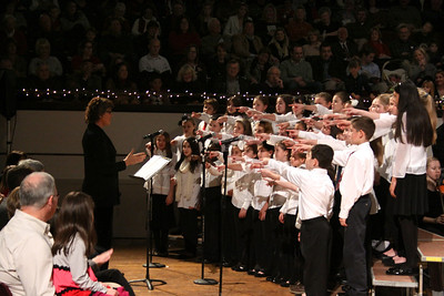 """Federal Furnace School Treble Chorus lead by Kathy McMinn, sing and act out the song """"I Want a Hippopotamus for Christmas""""."""