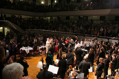 The Plymouth Philharmonic, Federal Federal Furnace School Treble Choir, and tenor Mathew Anderson, receive a long and loud standing ovation by the sold out Memorial Hall audience at the conclusion of the Holiday Pops concert.