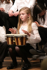 """Molly Long of Plymouth plays bongos in the song """"African Noel""""."""
