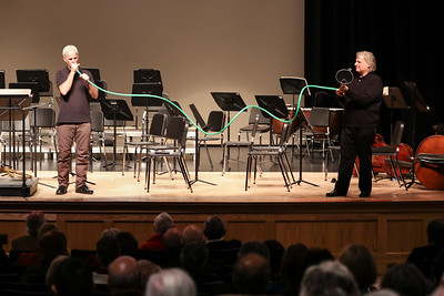 During the Pre-Concert Talk with Steven Karidoyanes, guest musician, renowned horn player Richard Sebring demonstrates how to make music with garden house and a funnel!  Wicked Local Photo/Denise Maccaferri