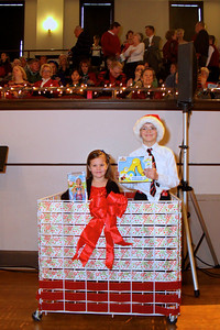 Jennifer Comier Fosdick and Justin Fosdick could not wait to bring toys to the Plymouth Area Coalition Holiday Fund collection box, on Sunday afternoon at the Plymouth Phil Holiday Pops concert.