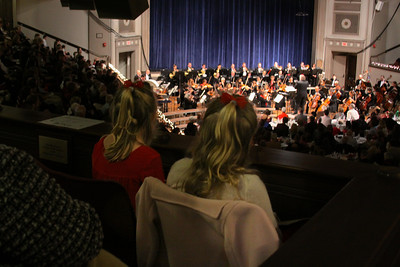 Two young ladies, along with  1198 others in the sold out Memorial Hall, enjoy the Plymouth Philharmonic Holiday Pops last Sunday afternoon.