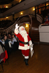 Santa arrives at Memorial Hall on Saturday night during the Plymouth Philharmonic Holiday Pops concert.